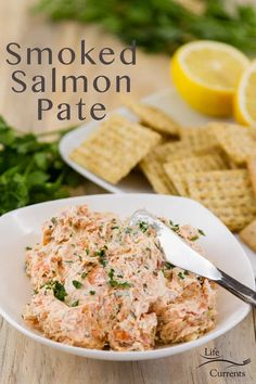 Smoked Salmon Pate with the spread in a white dish with a knife served with crackers, lemons, and fresh parsley Pate Recipes, Lunch Recipes, Beef Recipes, Appetizer Recipes, Southern Appetizers, Fancy Appetizers, Seafood Dishes, Seafood Recipes, Smoked Salmon Pate