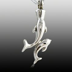 The Dolphin Cremation Jewelry is made of stainless steel and created by artist jewelers. The quality is incomparable and the craftsmanship outstanding. This Keepsake Pendant can hold a small amount of the cremation ashes or a piece of hair to memorialize your loved one forever. You can keep your loved one close to your heart at all times.  Top opening screw.
