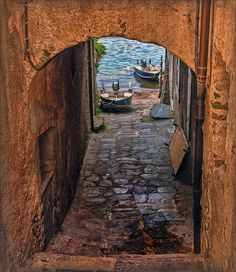 This narrow areaway alley between two houses on the Island San Giulio, in Italy…