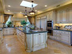 Mediterranean Kitchen with U-shaped, Undermount sink, Simple granite counters, Limestone Tile, Kitchen island, Flush
