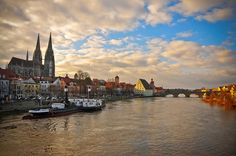 Danube River with Old Stone Bridge (Steinerne Brücke) and Tower and Cathedral in Regensburg Germany