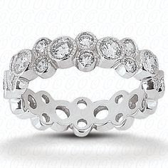 Multi-Stone Eternity Band set with (27) diamonds for a total weight of 1.44cts, This can also be customized using other colored stones and it is available in different metals as well.  Style # EWB237