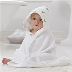 The Aden and Anais Hooded Towel/Washcloth Set is a bath time necessity for babies.