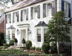 White Colonial with metal roof and black gas lanterns. #dream #home +++Visit http://www.thatdiary.com/ for guide + advice on #lifestyle