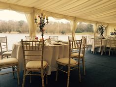 Limewash Chiavari chairs with ivory seat pads
