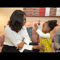 A photo of a little girl admiring Michelle Obama's portrait at the Smithsonian National Portrait Gallery is going viral for the sweetest reason. Two-year-old