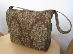 Tutorial: Hip Mama Diaper Bag-- This bag's finished dimensions are: 14″ long, 12″ high, 5″ wide, with a 36″ long strap. You can customize the bag, use fabric instead of waterproof vinyl, etc.