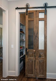 A sliding door to the pantry is a charming addition. The Monarch Manor house plan 5040. #WeDesignDreams