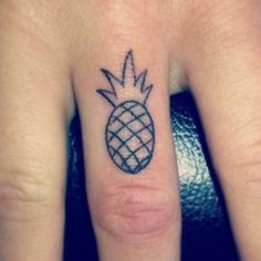 a simple pineapple tattoo on the knuckle like this would be so cute!