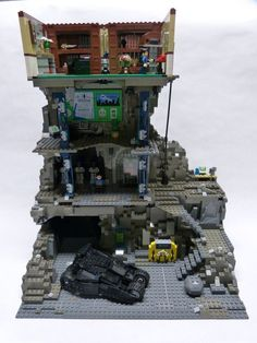 LEGO Batcave with Wayne Manor room that has the bat cave entrance.