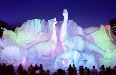 Dinosaur scene carved of snow, Sapporo Snow Festival, Hokkaido, Japan (© JTB MEDIA CREATION, Inc./Alamy)
