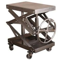 """Item # TA-4256     Industrial Adjustable Scissor Lift Table. Height is adjustable from 25"""" to 44"""". Top measures  32"""" x 20"""". Overall dimensions are 41"""" x 24"""" (including wheel handle)."""