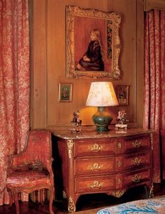 Renoir's Enfant Assis en Robe Bleu (Portrait of Edmond Renoir, Jr.), which dates from 1889, hangs above a Régence parquetry commode in the living room. The circa 1835 Staffordshire equestrian figures stand alongside one of a pair of Han pottery vases mounted as lamps. The corner chair is Louis XV.