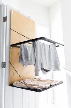 Tiny laundry nook update Today I'm sharing the build plans for the pull-down, door-mounted drying rack I made. Bonus: It has a spot for drying sweaters. Laundry Nook, Small Laundry Rooms, Laundry Room Storage, Laundry Room Design, Basement Laundry, Laundry Closet, Indoor Clothes Drying Rack, Drying Rack Laundry, Wall Mounted Drying Rack