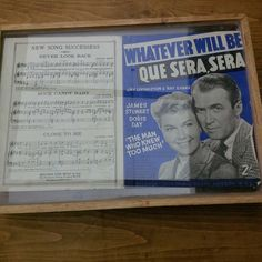 This was an old pine tray.  The wooden slats removed and an original song sheet added between 2 perspex sheets.
