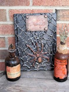 Arachnids spell book with two potion bottles. Ebay listing. Available till 09/22/13