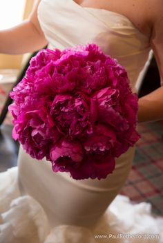 Pink peony wedding flower bouquet with Vera Wang dress gown at Spring Mackinac Island Wedding Little Stone Church Mission Point Resort Photography Sarah loves Charlie photo by Paul Retherford Wedding Photography #pink #peony #wedding #weddingbouquet #weddingflower #mackinac #verawang #weddingidea #weddingplanning