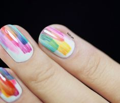 5 Easy Nail-Art Ideas For A Busy College Student || This is the nail style that intentionally looks messy. Bad-nail painters, this is your style! Paint a white base. With colors of your choosing, swipe a very thin layer of color on one spot of your nail. When the color is dry—which shouldn't take long because it is thin—swipe another color on. Continue until the nail looks like the picture shown above.