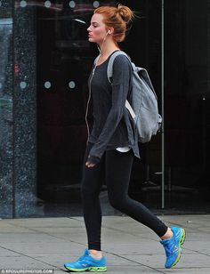 Cool customer: The About Time star teamed her tight-fitting bottoms with a long grey jumper and matching backpack
