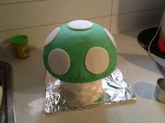 Here's the birthday cake I mentioned the other day when I was asking about baking times for a large cake. The 1UP mushroom from Super Mario! I swear to god I've been through the emotional rollercoaster with this cake, and it took me a day and a half but it's finally DONE. If you really want to…