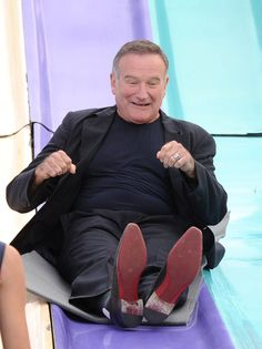 Pin for Later: Look Back on Robin Williams's Extraordinary Life in Pictures Robin got playful on a giant slide at the LA premiere of Happy Feet Two in November Happy Feet Two, Robin Williams Quotes, Oh Captain My Captain, Entertainment Tonight, Man Humor, Comedians, Loafers Men, My Idol, How To Memorize Things