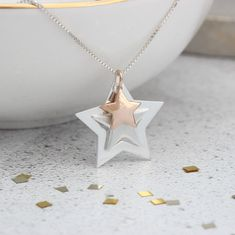 Are you looking for the perfect gift for someone special, maybe for her birthday or Christmas?  How about this gorgeous triple star necklace in silver with a rose or yellow gold vermeil star? #jewellery #jewelry #star #necklace #silver #gold #wedding #boho #handmade #three #rosegold #pendant #christmas