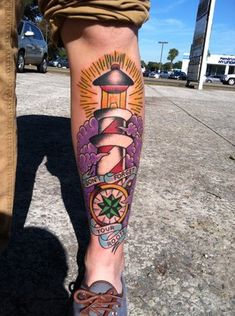 The Latest Lighthouse And Compass Tattoo On Leg