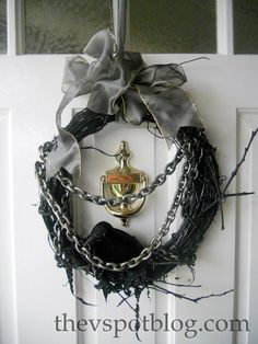 Dollar store halloween wreath with chains and crow