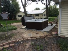 Here is a Master Spas Legacy installed on a concrete patio.