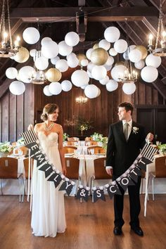 Minted's New Wedding Reception Decor Packages, botanical wreath theme, gold, white, lanterns, chandeliers, table runners, banner, groom, bri...