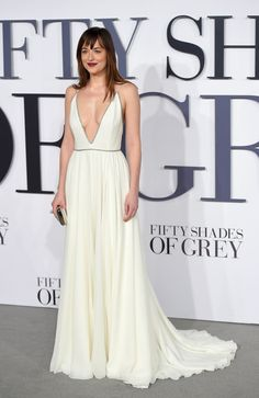 Johnson channels her inner goddess in a low-cut Saint Laurent gown at the London premiere of Fifty Shades of Grey.   - ELLE.com