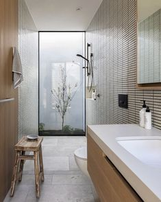 Veiled by a series of white perforated screens Nelson House by Neil Architecture layers materials landscape and spaces to create a balance between seclusion and connection to the surrounding urban context Bathroom Wall Decor, Bathroom Colors, Bathroom Styling, Bathroom Interior Design, Colorful Bathroom, Bathroom Designs, Dyi Bathroom, Remodel Bathroom, Master Bathroom