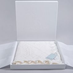 Looking for the perfect new baby or christening gift? Our elegant baby shawl is knitted from soft wool and hand finished with lace scalloped edges. Baby Shawl, White Shawl, New Baby Products, Pure Products, Newborn Baby Gifts, Christening Gifts, White Gift Boxes, Lace Design, Hand Knitting