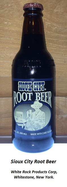 ROOT BEER REVIEW, Sioux City Root Beer: Another beverage in the Sioux City brand. This root beer is very similar to their Sarsaparilla offering. Same burnt sugar aroma. Same moderately foamy head. Very sweet, though perhaps not quite as toothachingly sweet as the Sarsaparilla. The aftertaste has a rooty zip that seems rather artificial in flavor.