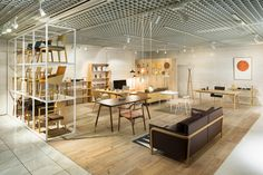 TAIYOU no SHITA is a minimalist interior located in Tokyo, Japan, designed by Mikiya Kobayashi. The furniture store features natural wood pieces ranging from shelving units to accessories. The ceiling...