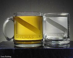 This etched glass coffee mug is for you, or for the Scuba Divemaster in your life that has everything. You are looking at ONE etched glass coffee mug. It has a Scuba Dive Flag and 'DIVEMASTER' etched Glass Coffee Mugs, Beer Mugs, Coffee Cups, Glass Tray, Glass Vase, Etched Gifts, Gifts For Scuba Divers, Dive Flag, Etched Wine Glasses