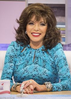 Looking glam: Joan sported a turquoise patterned dress on the ITV daytime show, and joked her husband Percy Gibson, who is 32 years her juni...