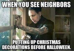 people-putting-up-christmas-decorations-before-halloween