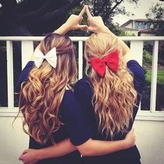 I love the hair w/ the bows! Also the way the two are posing like they could be bffs. I would so do this with my bff!