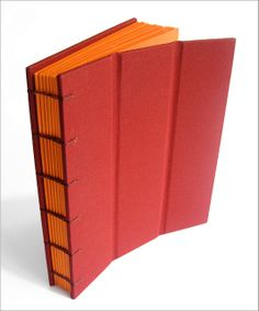 red and orange handmade journal with flexible cover by Zoopress Studio