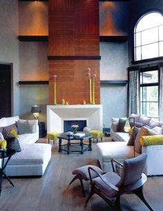 Modern Chic Livin Room...Love the mixture of warm fireplace mantel with light floors and pop of citrine.