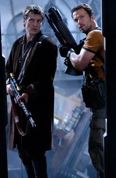 Still of Adam Baldwin and Nathan Fillion in Serenity || Men with big guns, how can you resist?