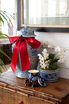 We love this Christmas display that features blue and white ginger jars and orchids. We have added some Christmas spirit with our red berry candle ring, red ribbon and a red berry pick. Blue Christmas, Christmas Holidays, Christmas Crafts, Merry Christmas, Christmas Wishes, Christmas Ideas, Christmas Interiors, Decorated Jars, Xmas Decorations