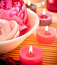 Decorating with candles. Candles roses. Flowers and lighting. Decoration bathroom.