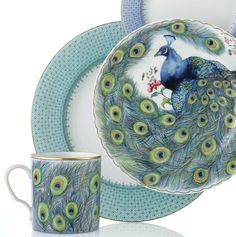 Mottahedeh's Peacock Feather dessert plates add a bit of charm to your Cornflower Lace dinner pattern.