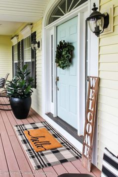 Front porch deocr and repainting front door Behr Nature's Reflection Front Porch Makeover, Front Door Porch, Front Door Decor, Front Porches, Front Doors, Front Porch Decorations, Fromt Porch Ideas, Front Porch Plants, Front Door Rugs