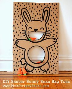 DIY Easter Bunny Bean Bag Toss. Set up a simple cardboard Easter bunny bean bag toss game with carrot bean bags. Kids will have fun playing this in party.