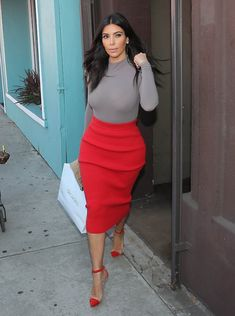 Kim out October 20.  -wolford bodysuit - alexander wang skirt -christian loubutin heels