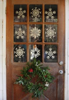 Deck out your front door with paper snowflakes.