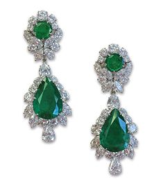 A PAIR OF EMERALD AND DIAMOND EAR PENDANTS by Van Cleef & Arpels set with 2 pear shaped Colombian emeralds weighing a total of approximately 27.66 carats and 2 emeralds on top weighing a total of approximately 6 carats and a total of approximately 23 carats of marquise, brilliant-cut and pear-shaped diamonds. Mounting in Gold.